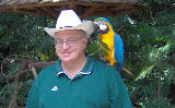 David with macaw on shoulder